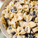 bow tie pasta in a bowl with mushrooms and leeks