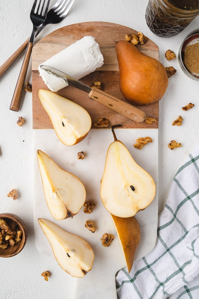 pears and walnuts on a serving platter.