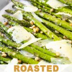 a baking sheet of asparagus with pine nuts and parmesan