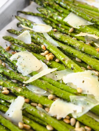 Asparagus on a sheet pan with parmesan and lemon