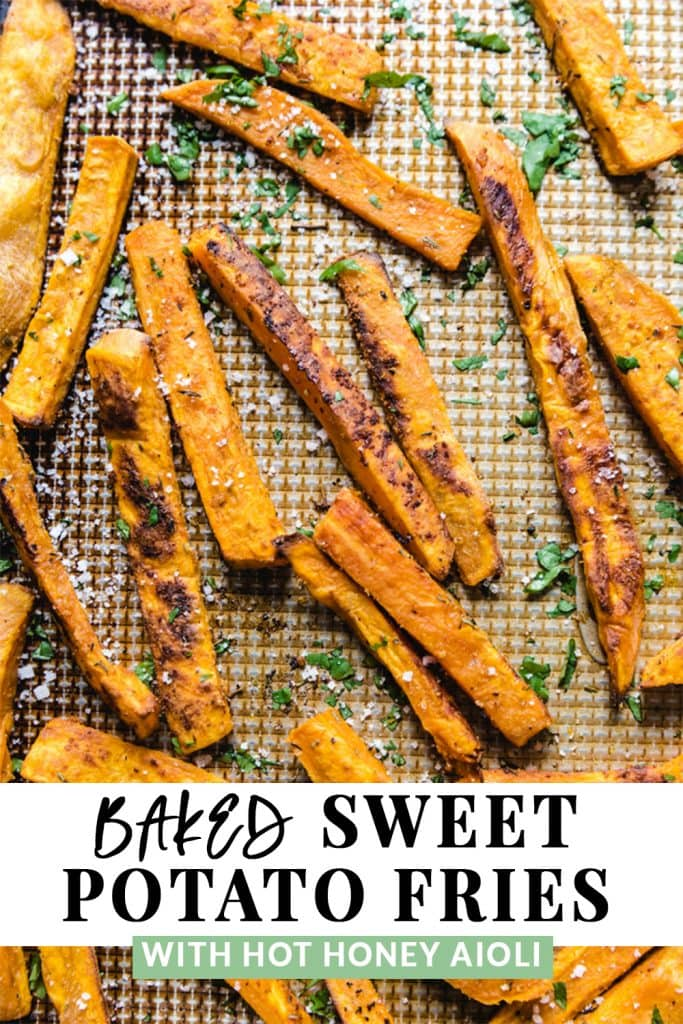 Baked sweet potato fries on a sheet pan with toppings.