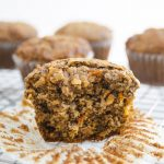 carrot apple breakfast muffins with a bite taken out of it.