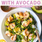 tossed salad in a bowl with greens and shrimp