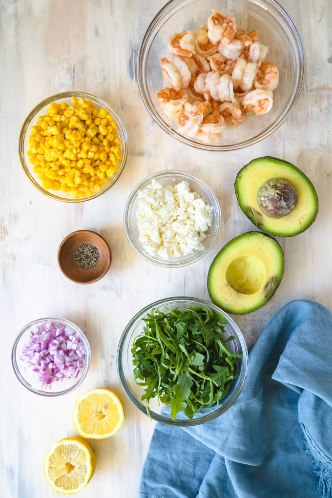 ingredients for salad in separate bowls.