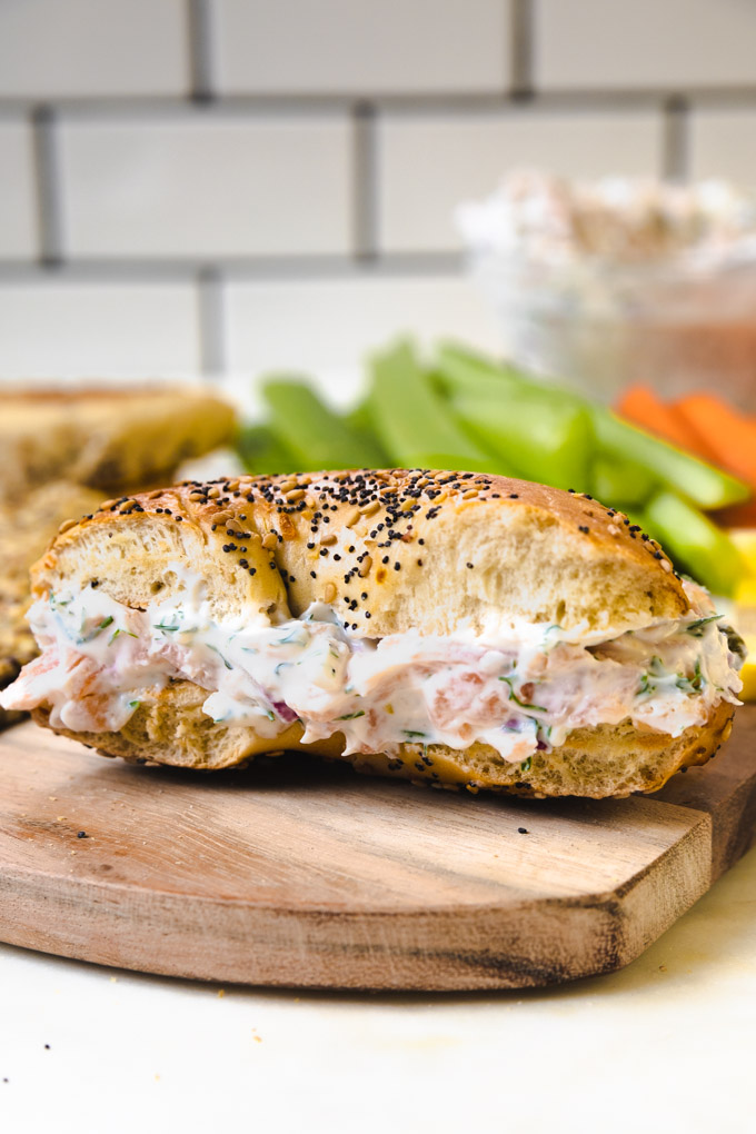 smoked salmon dip on a bagel folded into pieces.