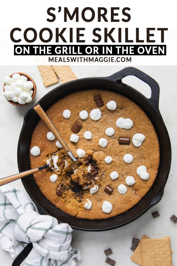 marshmallows and chocolate cookie in a cast iron skillet with text over it.