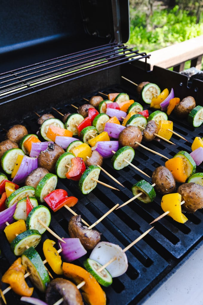 vegetable kabobs on a grill outside.