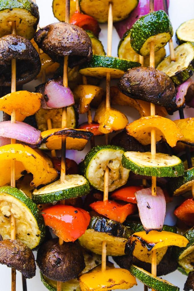 Grilled vegetable kabobs on wooden skewers.