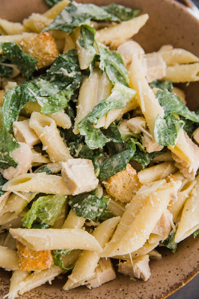pasta coated with caesar dressing
