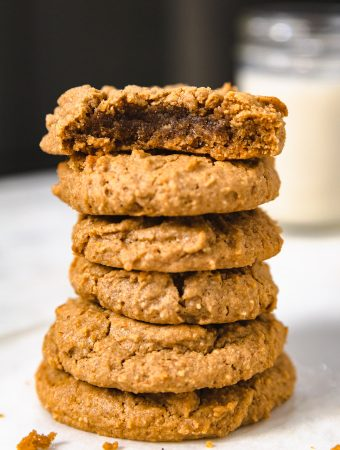 stack of peanut butter cookies with a bite mark.