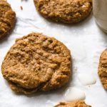 peanut butter cookies on a sheet pan with milk