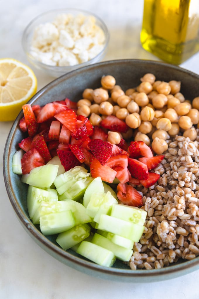 A plate of unmixed ingredients for farro salad.