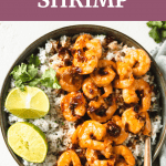 Shrimp with rice and lime in a bowl.