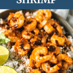 Shrimp with sauce on it and lime in a bowl