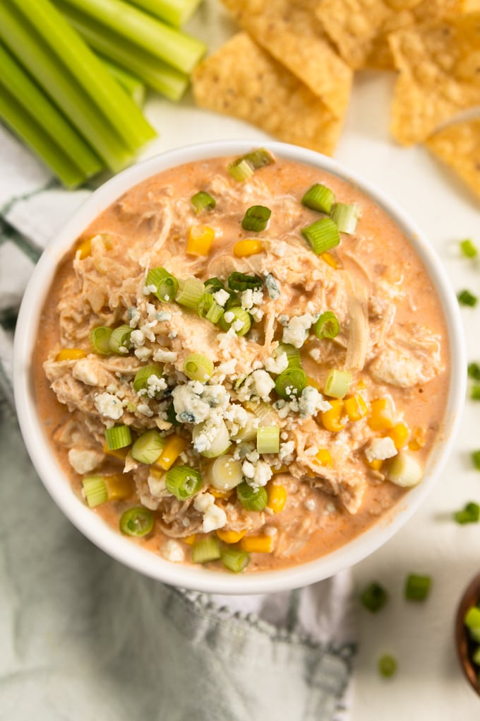 buffalo chicken dip with blue cheese and scallions on top.